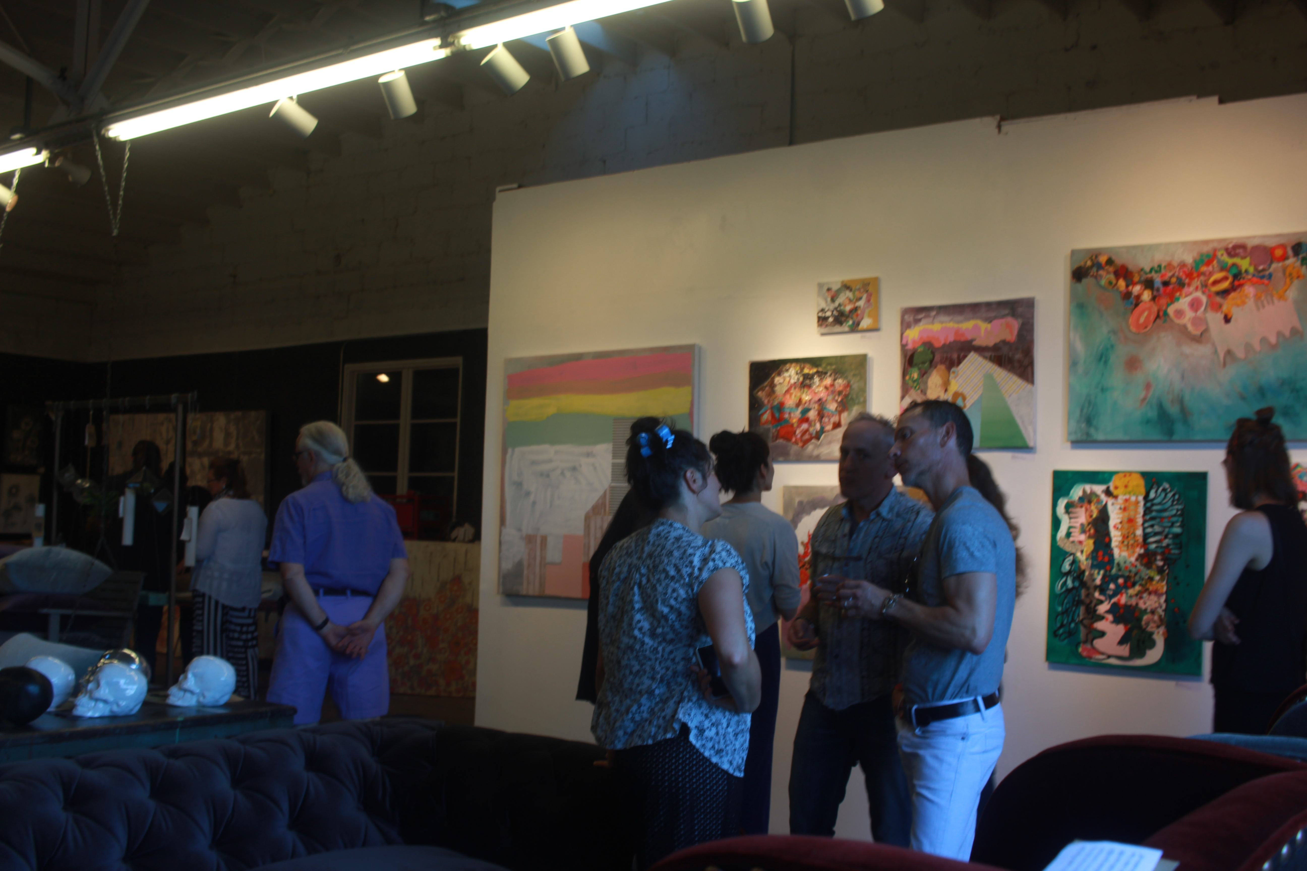 uests chat at the gallery opening of Ursula Gullow's exhibit 'Confetti' on June 10th at London District Studios.